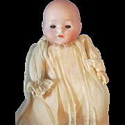 "Adorable 9 l/2"" Antique All Original German Recknagel Bisque Head Pouty Baby, circa 1910"