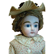 19 In. Bisque Turned Shoulder Head, Closed Mouth with White Space Between Lips, Antique Clothe