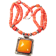 Twenty Inch Coral Colored Necklace with Large Tibetan Pendant