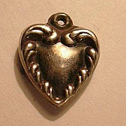 Silver Heart Charm Repousse From A Fine Collection of Puffy & Sterling Hearts