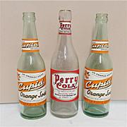SOLD Two Cupid Orange Soda Bottles