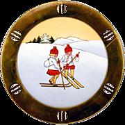"Irresistible German Brass Framed Porcelain ""Skiing Children"" Plate Darling!"