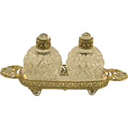 A Brilliant Pair of Round IRICE Bottles with Mirrored Tray