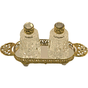 A Lavish Pair of Cylindrical IRICE Bottles with Mirrored Tray