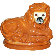 SALE Staffordshire Lion circa 1900 with glass eyes in excellent condition.