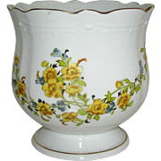SALE Jardinaire of Cache Pot with a floral motif in yellows, greens, and browns, 20th c.