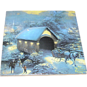 Hot plate, Thomas Kinkade painting depicted, cork backed, lovely!