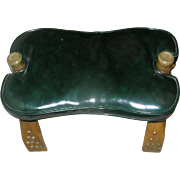 Camel back stool with a leather-like cushion of dark, dark, dark, green, excellent condition .