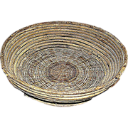 SOLD Hand made primitive basket made of thick reed rods
