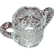 SALE Pressed single creamer with a daisy pattern on the side...highly unusual...very heavy ...