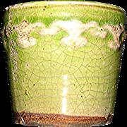 Miniature stoneware crock with off white fleur de les