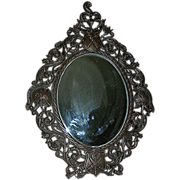 REDUCED Mirror, beveled original set in Spelter, late 19th century