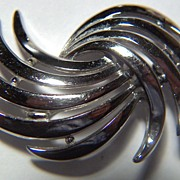 Vintage signed Crown Trifari Bright Silver-toned Swirling Comet Pin Brooch