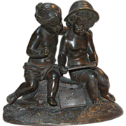 After ALFRED-LOUIS HABERT, Bronze Sculpture of Putti Drawing