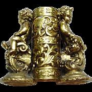 Gold-Tone Metal Lipstick Holder, Cupids and Scrolls