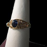 9kt Yellow Gold Oval Facet Cut Medium Blue Sapphire/Diamonds Ladies Ring