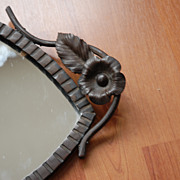 A Rare Art Nouveau Quality Wrought Iron Eye Mirror With Leaf Motif