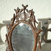 Decorative Antique Swiss Black Forest' Mirror in Carved Wood(walnut) Floral Frame