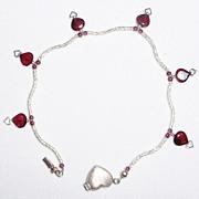 Sterling Silver Swirls and Garnet Hearts - Bracelet