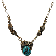 Delicate Sterling Silver Necklace with Oval Turquoise Pendant Decorated with Flowing Leaves an