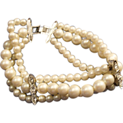 SALE VINTAGE 3 strand faux cream pearl bracelet with rhinestone spacers