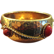 VINTAGE Hammered Brass bangle with marbleized deep red cabochons