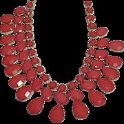 SALE VINTAGE Tear Drop Orange lucite bib necklace in 3 rows in gold tone