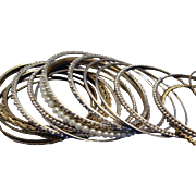 SALE VINTAGE Collection of 16 silver tone/ and gold tone textured spacer bangles some with rhi