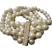 SALE VINTAGE 4 Strand stretch 8mm pearl bracelet with rhinestone center