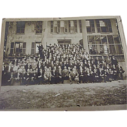Large Picture Men In Front of House