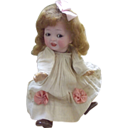 Googly Doll With Sleep Brown Eyes and Dimples, Closed Mouth With Molded In Teeth