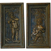 SOLD Antique pair of framed iron cupid wall plaques HOLD FOR J