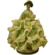 Dresden lacy  figurine woman holding fan