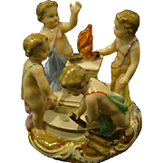 Meissen antique porcelain figurine four cupids dancing around the open flame