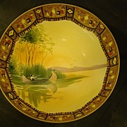Nippon Indian in canoe scenic large footed bowl