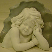 Unusual parian bust of young girl against rock figurine