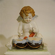 SALE Scheibe Alsbach seated cupid figurine playing drums