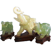 Early 20th Century Chinese Jade Elephant Trio on Rosewood Stands with Inlaid Silver Decoration