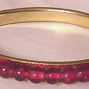 Vintage Ruby / Garnet Red Glass and Brass Bangle Bracelet
