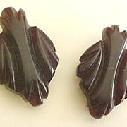 Pair of Carved Brown Bakelite Dress Clips