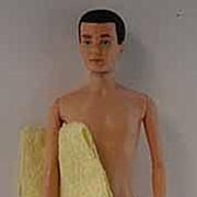 Mattel 1961 Brunette Flocked Hair Ken Doll with Accessories.