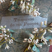 SOLD Battered old French doll's box with label TROUSSEAU DE MA POUPEE
