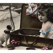 SOLD Child in Suitcase with Jack Russell Toy Art Deco French Postcard