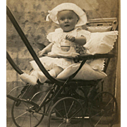 SOLD Toddler in Baby Buggy Holding Rattler Toy Vintage Real Photo Postcard