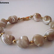 Beautiful Natural Champagne Color Mother Of Pearl Single Strand Bracelet