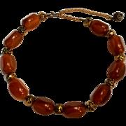 Bakelite bead necklace metal rose beads amber colored bakelite