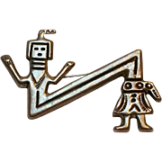 Native American sand cast sterling silver man figure pin zig-zag
