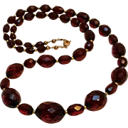 Cherry amber bakelite bead necklace faceted beads
