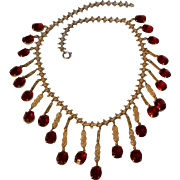 Vintage fringe necklace red glass stone and filigree plaque drops
