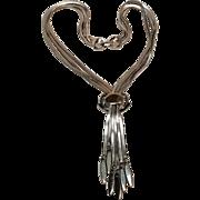 Monet multi chain necklace with a slide tassel pendant